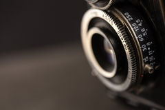 Detail of the lens of a very old camera Stock Photography