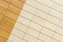 Light beige tile wall texture background Stock Images