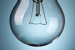 Detail of light bulb on blue background Royalty Free Stock Photos