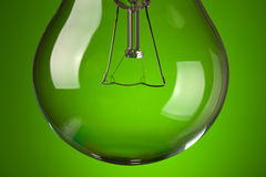 Detail of light bulb on green background Stock Photography