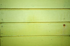 Detail of lime green wall from a beach hut. Stock Images