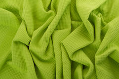 Detail of lime mint tissue. Crumpled blue fabric texture closeup Royalty Free Stock Images
