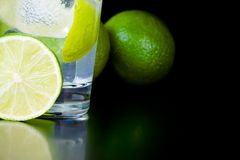 Detail of lime slice near cocktail with ice and space for text Stock Photography