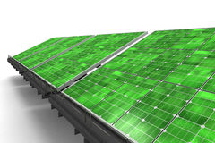 Detail of a line of green solar panels Royalty Free Stock Photo