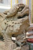 Detail of Lion guardian on Wat Phra Kaew, Temple of the Emerald Buddha at Bangkok royalty free stock images