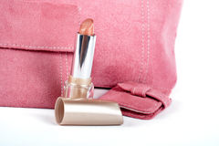 Detail of lipstick and Assortment of pink handbags Stock Image