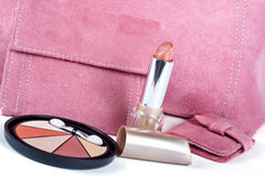 Detail of lipstick and Assortment of pink handbags Stock Photography