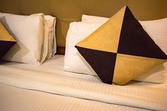 Decorative cushion on bed. Detail of a living room with double bed and beautiful cushion on it stock photos