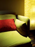 Detail of living room with lamp and green sofa Stock Photo