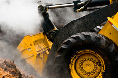 Detail Loader And Piles Of Steaming Mulch Stock Images