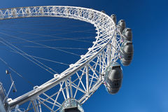 Detail of the London Eye with a clear blue sky Stock Images
