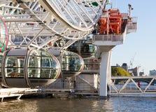 LONDON, UK - OCTOBER 1, 2015: London Eye ferris wheel on bank of Thames Royalty Free Stock Photos