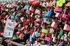 Love locks hanging on the handrails at the Korean Namsan Seoul Tower. A detail of the love locks hanging on the handrails at the Korean Namsan Seoul Tower. Big stock photography