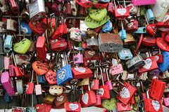 Love locks hanging on the handrails at the Korean Namsan Seoul Tower. A detail of the love locks hanging on the handrails at the Korean Namsan Seoul Tower. Big royalty free stock photo