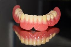 Detail of the lower dental prosthesis in resin Royalty Free Stock Photography