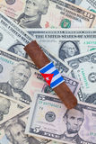 Detail of luxury Cuban cigar on the US dollars Royalty Free Stock Photos