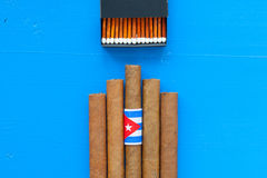 Detail of luxury Cuban cigars on the blue table Royalty Free Stock Image