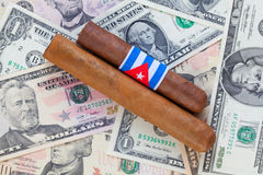 Detail of luxury Cuban cigars on the US dollars Stock Photography
