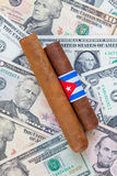 Detail of luxury Cuban cigars on the US dollars Stock Photo
