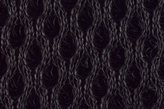 Abstract black knitted fabric background royalty free stock photo