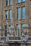 Detail of majestic building with sculptures of women Stock Images