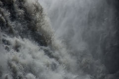 Detail of majestic waterfalls with rocks around Royalty Free Stock Photo