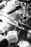 Detail of making espresso coffee with machine bw Stock Image