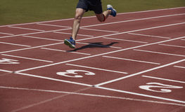 Detail of a male athlete crossing the finish line Stock Image