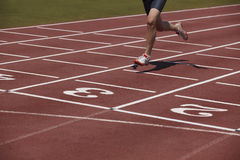 Detail of a male athlete in a running track Stock Images