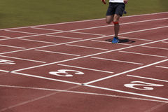Detail of a male athlete in a running track Royalty Free Stock Image