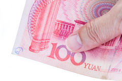Detail of male hand holding hundred Chinese RMB banknotes on whi. Te background, business and finance concept Royalty Free Stock Photo