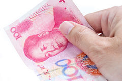 Detail of male hand holding hundred Chinese RMB banknotes on whi. Te background, business and finance concept Stock Photo