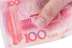Detail of male hand holding hundred Chinese RMB banknotes on whi. Te background, business and finance concept Royalty Free Stock Image