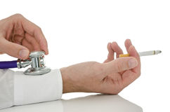 Detail of male hand holding stethoscope on a smoker arm. Who is holding a cigarette. Isolated over white Stock Photo
