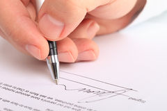 Detail of a male hand signing a contract Royalty Free Stock Photos