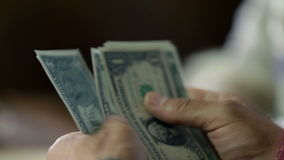 Detail of male hands amid counting the bank notes stock video