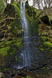 Detail of the Mallyan Spout Waterfall spilling over moss and rocks, Goathland Stock Photos