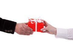 Detail of a man giving a gift to a woman Stock Photography
