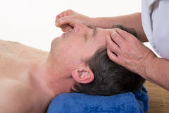 Detail of man receiving an acupuncture needle therapy Stock Photos