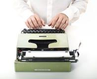 Detail of man with typewriter. Selective focus image Royalty Free Stock Photos