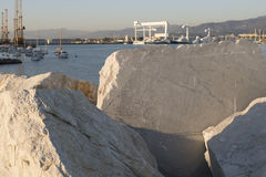 detail of marble block in the harbour of marina di carrara Stock Photography