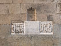 Detail of marble with Gothic writing, with a passage of the bible. Cathedral of Barcelona. Barcelona, Spain. Detail of marble with Gothic writing, with a passage stock images