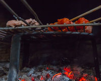 Detail of meat on barbecue fire Royalty Free Stock Photography