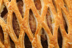 Detail of a meat pie. With decorated top Royalty Free Stock Photos