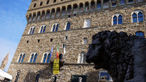 Detail of Medici Lion view from Loggia dei Lanzi with Palazzo Vecchio building on the background, Florence, Italy Royalty Free Stock Photos