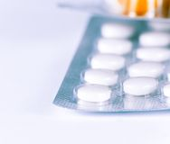 Detail of medicine pills and capsules packed in blisters Stock Image
