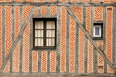 Detail. Medieval building. Tours. France. Wall with Windows and bricks and beams pattern. Detail of a Medieval buildings  in the old town. Tours. France Stock Images
