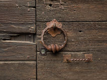 Detail of medieval door rusty knocker and handle Royalty Free Stock Photos
