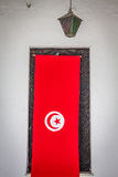 Detail of Medina in Sousse, Tunisia with flag Royalty Free Stock Images