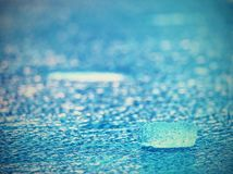 Detail of melting ice block floating in the river. Frozen river surface royalty free stock images